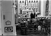 28/07/1962<br /> 07/28/1962<br /> 28 July 1962 <br /> Wedding of Mr Desmond F. English, Landscape Cresent, Churchtown and Miss Blanche O'Brien Oakley Park, Blackrock at St John the Baptist Church, Blackrock and Ross's Hotel Dun Laoghaire, Dublin. Image shows the ceremony in progress with a view of the altar.