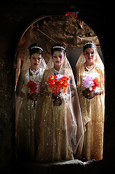 Three young brides Sidaba Saleh Ali Wardan, 11, Qawla Hameed Saleh Wardan, 12, and Galiya Saleh Hameed Wardan, 13,  are married to three brothers during a combined ceremony in the rural areas outside Hajjah.