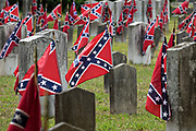 Confederate battle flags mark the tombs of Confederate soldiers during Confederate Memorial Day at Magnolia Cemetery May 11, 2019 in Charleston, South Carolina. Confederate memorial day continues to be an official state holiday in South Carolina where the American Civil War began.