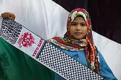 April 13, 2018 - Kuala Lumpur, Malaysia - A young protester pictured in front of a Palestinian flag during a rally to commemorate Palestinian Land Day at outside of the US embassy in Kuala Lumpur, Malaysia on April 13, 2018. The protests are being held around the world. (Credit Image: © Chris Jung/NurPhoto via ZUMA Press)