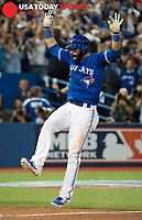 Oct 14, 2015; Toronto, Ontario, CAN; Toronto Blue Jays right fielder Jose Bautista (19) reacts to his three run homer against Texas Rangers in the seventh inning in game five of the ALDS at Rogers Centre. Mandatory Credit: Peter Llewellyn-USA TODAY Sports