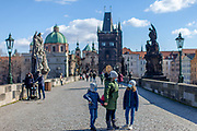 A mum with her children with face masks on Charles Bridge. On March 1st, 2021 the state of emergency in the Czech Republic was reinstalled because of fast increasing numbers in infections. The lockdown was reinstated and the restriction of the free movement of people has taken effect. Currently, the country remains at the highest stage of the anti-epidemiological system and the newly imposed restriction will last at least three weeks to curb the epidemic.