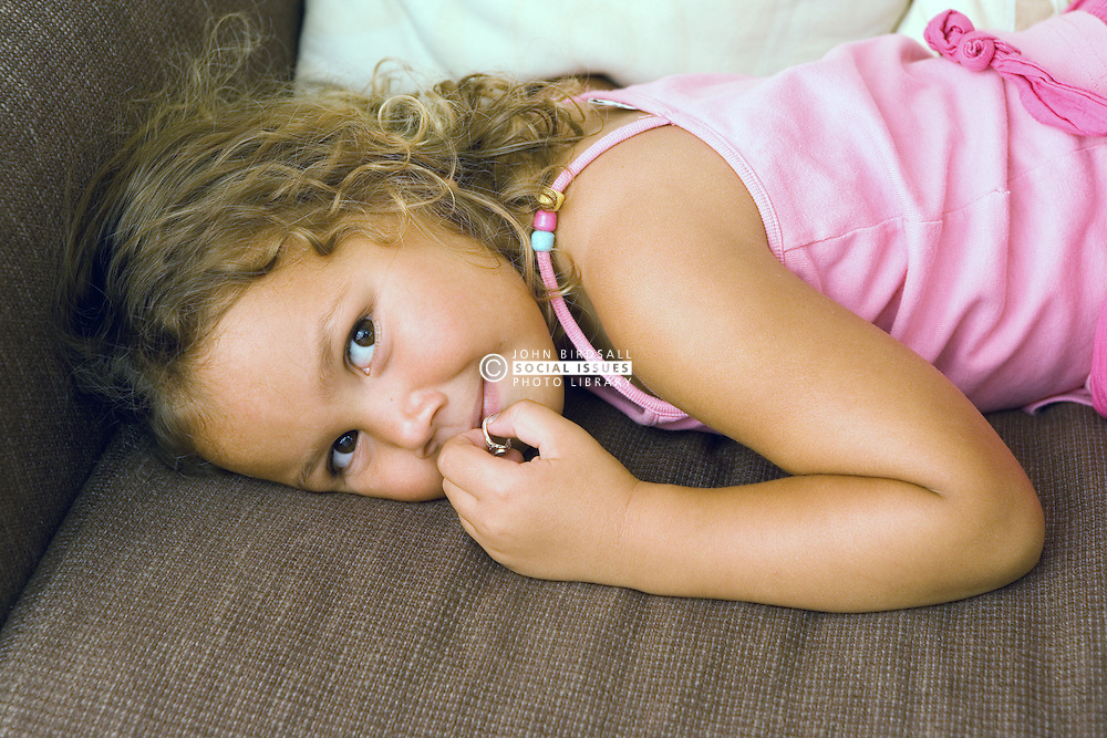 Young girl lying on the sofa smiling,