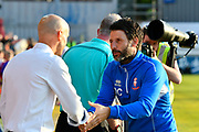 Exeter City manager Paul Tisdale shakes hands with Lincoln City manager Danny Cowley before the EFL Sky Bet League 2 match between Exeter City and Lincoln City at St James' Park, Exeter, England on 17 May 2018. Picture by Graham Hunt.