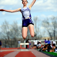 033013       Adron Gardner<br /> <br /> Miyamura Patriot Amy Rosebrough leaps for a long jump attempt during the Gallup Invitational at Public School Stadium Saturday.
