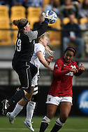04 December 2011: Stanford's Emily Oliver (19) grabs the ball over Duke's Kaitlyn Kerr (center) and Stanford's Mariah Nogueira (20). The Stanford University Cardinal played the Duke University Blue Devils at KSU Soccer Stadium in Kennesaw, Georgia in the NCAA Division I Women's Soccer College Cup Final.