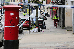 © Licensed to London News Pictures. 24/04/2019. London, UK. A crime scene on Harlesden High Street, Brent in West London where a 21 year old man was stabbed to death on Tuesday 23 April 2019 at about 9pm. The victim was pronounced dead at a hospital just before 3am on early this morning. Photo credit: Dinendra Haria/LNP