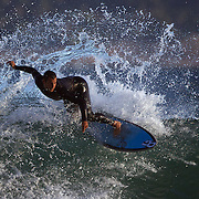 Surfers in action during a big swell in the late afternoon sun at Arpoador Beach near Apoador Point, Rio de Janeiro,  Brazil. 18th August 2010. Photo Tim Clayton.