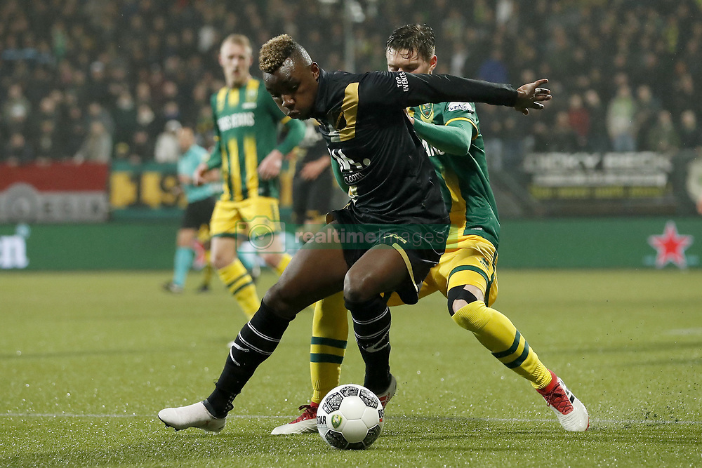 (L-R) Thierry Ambrose of NAC Breda, Danny Bakker of ADO Den Haag during the Dutch Eredivisie match between ADO Den Haag and NAC Breda at Cars Jeans stadium on March 10, 2018 in The Hague, The Netherlands