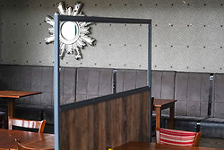 © Licensed to London News Pictures. 02/07/2020. Sheffield , UK. Plastic protective  screens have been placed  between tables  at a branch of Weatherspoons in Sheffield  as it prepares to reopen its doors.  Pubs, restaurants, hairdressers, theatres, hotels, museums and galleries will reopen on July 4th, following a nationwide lockdown against the spread of the coronavirus disease. Photo credit: Ioannis Alexopoulos/LNP