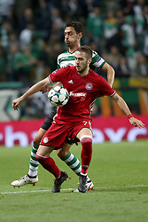 November 22, 2017 - Lisbon, Portugal - Olympiacos' Greek midfielder Kostas Fortounis (R ) fights for the ball with Sporting's defender Andre Pinto from Portugal during the UEFA Champions League group D football match Sporting CP vs Olympiacos FC at Alvalade stadium in Lisbon, Portugal on November 22, 2017. Photo: Pedro Fiuza  (Credit Image: © Pedro Fiuza/NurPhoto via ZUMA Press)