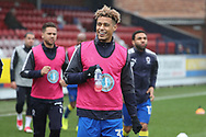 AFC Wimbledon striker Lyle Taylor (33), AFC Wimbledon attacker Harry Forrester (11) and \w17 walking out to warm up during the EFL Sky Bet League 1 match between AFC Wimbledon and Blackpool at the Cherry Red Records Stadium, Kingston, England on 20 January 2018. Photo by Matthew Redman.