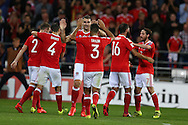 Sam Vokes of Wales ©  celebrates with teammates after he scores his teams 1st goal. Wales v Moldova , FIFA World Cup qualifier at the Cardiff city Stadium in Cardiff on Monday 5th Sept 2016. pic by Andrew Orchard,