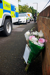 Police  launched double murder investigation following discovery of two female bodies in Wath upon Dearne Rotherham South Yorkshire. Floral Tribute and Note left outside131 Sandygate a cordoned off  bungalow in Wath Upon Dearn on Wednesday Morning by Friend of the Family<br /> 24 July 2013<br /> Image © Paul David Drabble<br /> www.pauldaviddrabble.co.uk