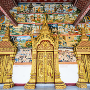 The three main doors at the temple of Wat Phonxay Sanasongkham in Luang Prabang, Laos.