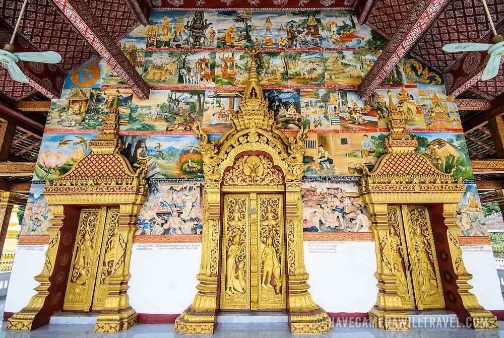 The three main doors at the temple of Wat Phonxay Sanasongkham in Luang Prabang, Laos.