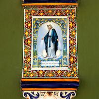 USA, Puerto Rico, San Juan. Virgin Milagros tile detail on facade in Old San Juan.