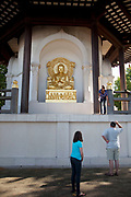 Buddhist Peace Pagoda in Battersea Park, South West London. This shrine / monument has gold Buddhas at each of it's facades.
