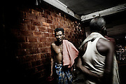 Christian refugees bath at YMCA relief comittee in Orissa's capital Bhubaneswar. .Nov.04, 2008.