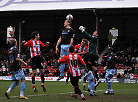 Photo: Tony Oudot/Richard Lane Photography. Brentford v Bury . Coca-Cola Football League Two. 28/02/2009. <br /> Goalkeeper Mark Tyler and centre half Ryan Cresswell clear their lines during a Brentford attack