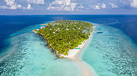 Aerial view of local island Omadhoo, located in Alif Dhaal Atoll, Maldives, Indian Ocean with reef, harbour, local beach, bikini / guest beach and sandbank