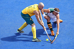 Justin Reid-Ross  of South Africa and Glenn Turner of Australia during the men's Hockey match between Australia and South Africa held at the Riverbank Stadium in the Olympic Park in London as part of the London 2012 Olympics on the 30th July 2012.Photo by Ron Gaunt/SPORTZPICS
