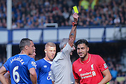Liverpool midfielder Emre Can  sees the funny side of his card during the Barclays Premier League match between Everton and Liverpool at Goodison Park, Liverpool, England on 4 October 2015. Photo by Simon Davies.