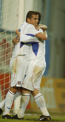 TEPLICE, CZECH REPUBLIC - Wednesday, April 30, 2003: Czech Republic's Milan Baros celebrates with Liverpool team-mate and goalscorer Vladimir Smicer after netting the 3rd goal against Turkey during a friendly match at the Teplice Stadion Na Stinadlech. (Pic by David Rawcliffe/Propaganda)