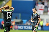 Gareth Bale of Wales reacts as he looks on dejected at the end of match after his team lose.  Euro 2016, group B , England v Wales at Stade Bollaert -Delelis  in Lens, France on Thursday 16th June 2016, pic by  Andrew Orchard, Andrew Orchard sports photography.