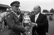 07/08/1987<br /> 08/07/1987<br /> 07 August 1987<br /> Bank of Irelands Nations Cup for the Aga Khan trophy competition at the Dublin Horse Show at the RDS, Dublin. President Hillery presenting the Aga Khan Trophy to Col. Ned Campion, Chef d'Equipe of the winning Irish team at the Dublin Horse show at the R.D.S., Dublin.