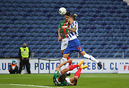 Alex Telles of Porto(R) jumps for the ball during the Portuguese League (Liga NOS) match between FC Porto and Maritimo at Estadio do Dragao, Porto, Portugal on 3 October 2020.