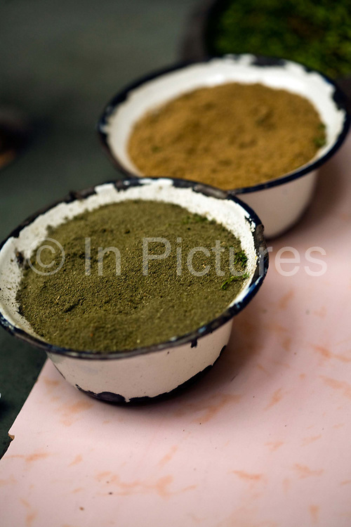 Dishes of spice in the kitchens at Moti Mahal Restaurant in Old Delhi, India<br /> The resturant opened in 1947 is widely credited with inventing the classic Delhi dish, butter chicken.