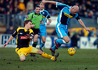 Photo: Alan Crowhurst.<br />Wycombe Wanderers v Stockport County. Coca Cola League 2. 28/01/2006. <br />Tommy Mooney (R) bursts through for Wycombe.