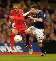 Photo: Richard Lane.<br /> Wales v Scotland. International Friendly. 18/02/2004.<br /> Paul Dickov of Scotland is challenged by Danny Gabbidon of Wales.