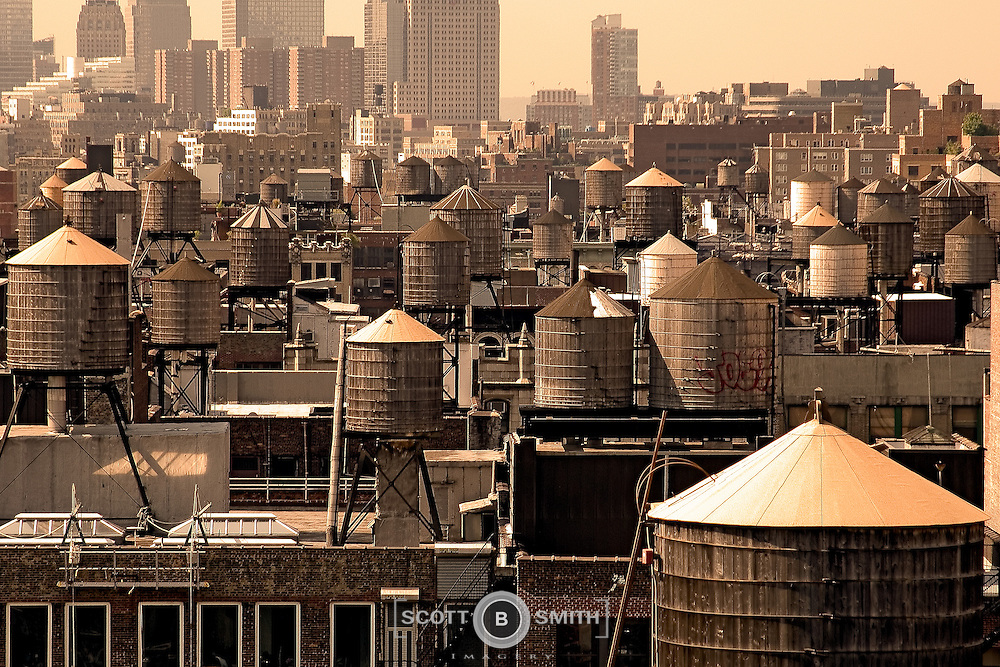 Wood constructed, roof mounted water storage tanks in New York City.
