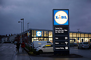 Supermarket chain Lidl store at night in the Kings Heath area of Birmingham, United Kingdom. Kings Heath is a suburb of Birmingham, three miles south of the city centre. It is the next suburb south from Moseley. Lidl Stiftung & Co. KG is a German global discount supermarket chain, that operates over 10,000 stores across Europe and the US. It belongs to Dieter Schwarz, who also owns the store chains Handelshof and hypermarket Kaufland.