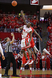 """31 January 2009: Referee Paul Janssen tosses the to start the game with Dinma Odiakosa getting the tip. The Illinois State University Redbirds join the Bradley Braves in a tie for 2nd place in """"The Valley"""" with a 69-65 win on Doug Collins Court inside Redbird Arena on the campus of Illinois State University in Normal Illinois"""