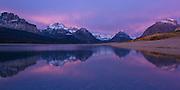 The Sunrise is Reflected in Lake Sherburne of Glacier National Park.