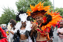 © Licensed to London News Pictures. 10/09/2017. LONDON, UK.  Dancers wearing bright coloured costumes take part in the Hackney carnival in east London.  Photo credit: Vickie Flores/LNP