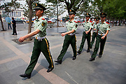 Members of the People's Liberation Army march past on Tiananmen Square. Part of a security detail in the city of Beijing, China.