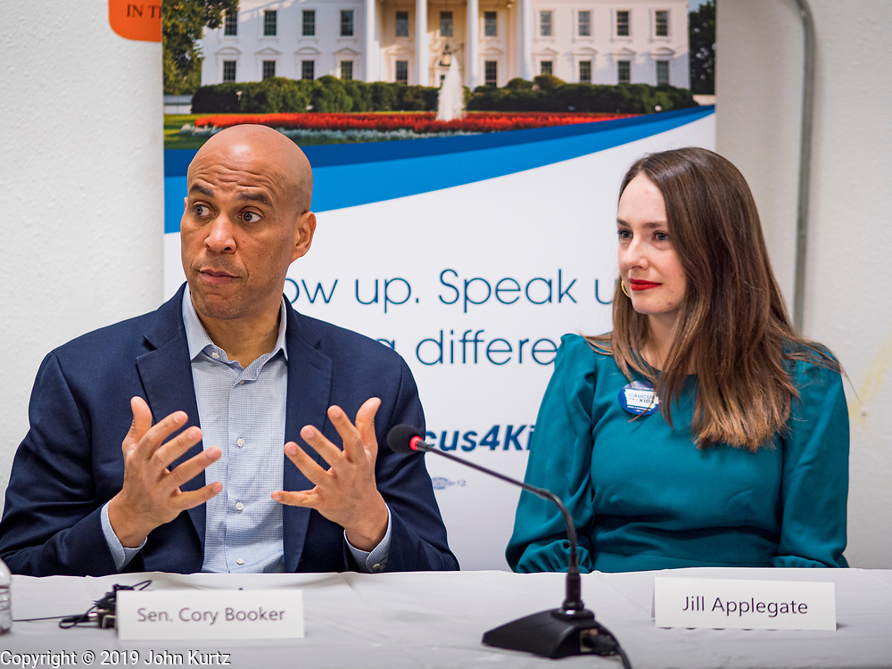 01 NOVEMBER 2019 - DES MOINES, IOWA: US Senator CORY BOOKER (D-NJ), left,  and JILL APPLEGATE at Conmigo Early Education Center. Sen. Booker visited Conmigo Early Education Center, a bilingual education center for children ages 1-5. He talked to staff about the needs of children. Booker is running to be the Democratic nominee for president and spoke later in the evening at the Liberty and Justice Celebration.           PHOTO BY JACK KURTZ