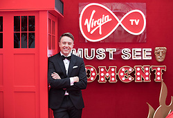 EDITORIAL USE ONLY<br /> Virgin TV's red-carpet host Roman Kemp take centre stage in Virgin TV's Must-See Moment Lounge at the Virgin TV British Academy Television Awards.