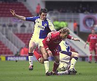 Photo. Glyn Thomas.<br /> Middlesbrough v Blackburn Rovers. Premiership. <br /> Riverside Stadium, Middlesbrough. 07/02/2004.<br /> Boro's Gaizka Mendieta (C) is brought down by Andy Todd (R) and John Douglas.