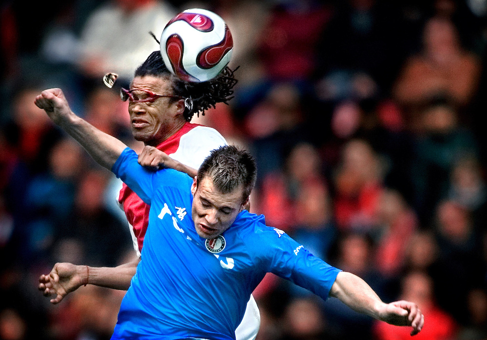 """The Netherlands, Amsterdam,04-02-2007.<br /> Football, National, Competition, Eredivisie.<br /> Ajax vs Feyenoord: 4-1.<br /> In a fair clash with Danny Buijs of Feyenoord the glass of the spectacles of Edgar Davids jumps out of the frame. Davids has the nickname """"the pitbull"""" and returned again to Ajax where he played years before.<br /> Photo: Klaas Jan van der Weij"""