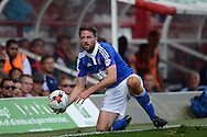 Cole Skuse of Ipswich Town collects the ball from the sidelines. Skybet football league Championship match, Brentford v Ipswich Town at Griffin Park in London on Saturday 8th August 2015.<br /> pic by John Patrick Fletcher, Andrew Orchard sports photography.