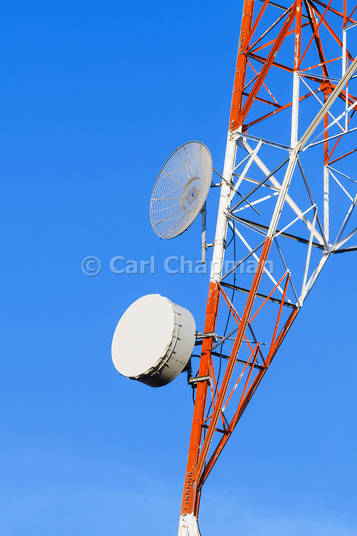 Microwave dish antenna on television broadcast transmission lattice tower <br /> <br /> Editions:- Open Edition Print / Stock Image