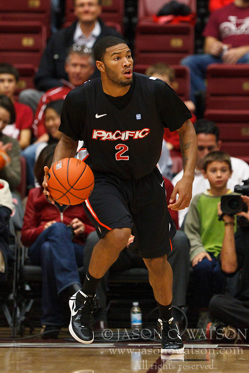 Nov 28, 2011; Stanford CA, USA;  Pacific Tigers guard Colin Beatty (2) dribbles the ball up court against the Stanford Cardinal during the first half at Maples Pavilion. Stanford defeated Pacific 79-37. Mandatory Credit: Jason O. Watson-US PRESSWIRE