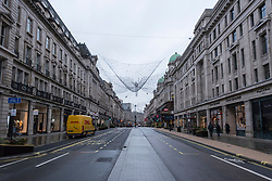 © Licensed to London News Pictures. 21/12/2020. LONDON, UK. A quiet Regent Street in the West End as Tier 4, Stay at Home, alert level restrictions are imposed on much of the UK to combat the ongoing coronavirus pandemic in the light of a recently discovered mutant strain that was discovered in the south east of England.  Photo credit: Stephen Chung/LNP