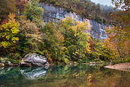 Fall foliage with large boulder in the Buffalo River just below Steel Creek, near Ponca, Arkansas.  The Nature Conservancy Calendar photo for November 2022