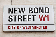 Sign for New Bond Street, known for being the most exclusive shopping street in London.